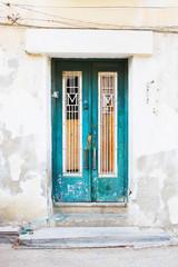 Old dilapidated abandoned wooden door.