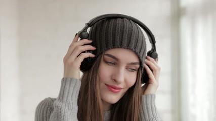 Young beautiful fashionable woman in big dj headphones phones en