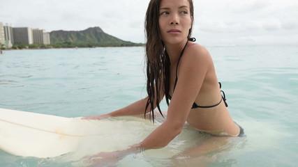 Surfer woman surfing on Waikiki Beach Hawaii