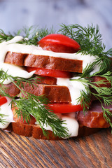 Sandwich with sausage, tomato and mayonnaise