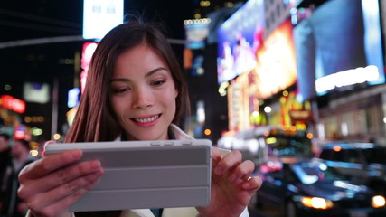 Tablet computer - woman using app in New York City