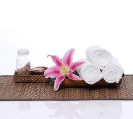beautiful lily, petals in glass with roller towel,salt in bowl