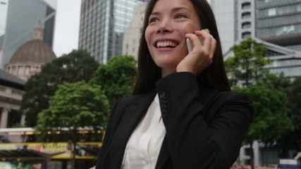 Asian business woman on smart phone in Hong Kong