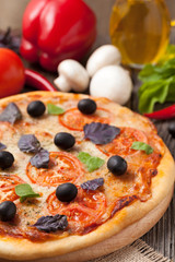 Italian pizza margherita with tomatoes, mushrooms, olives basil