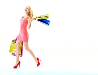 Delighted woman with lots of shopping bags