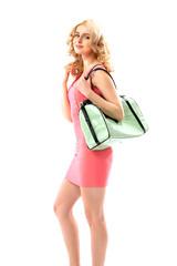 Blond beautie holding a trendy handbag
