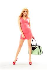 Beautiful blond woman holding a handbag