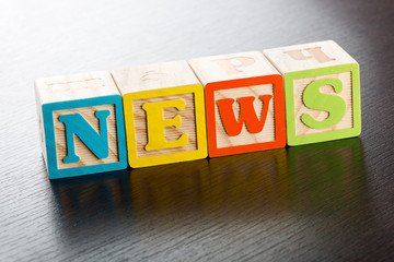 Colorful Children Blocks Spelling the Word News