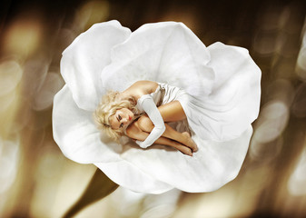 Conceptual picture of a lady in the flower