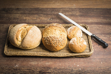 brown bread loafs with bread knife