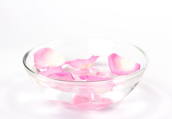 Infused water with rose petals in a reflection bowl