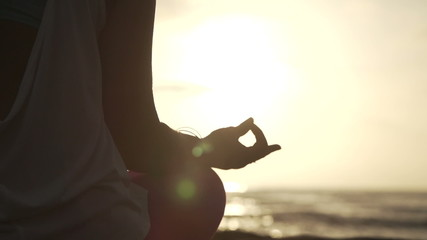 Close Up Hand Of Woman Meditating In a Yoga Pose On The Beach