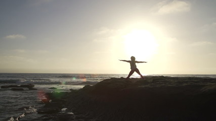 Wide Silhouette Woman Practicing Yoga On Beach