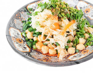 Chickpeas, cabbage, carrots, greens on the plate