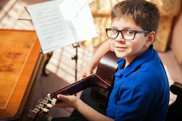 Cute kid during guitar lesson