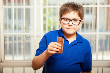 Young boy eating chocolate