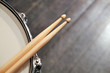 Drum sticks lay on an drum set - 79671999