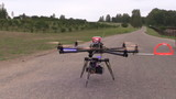 Octocopter copter with camera start and fly in air poster