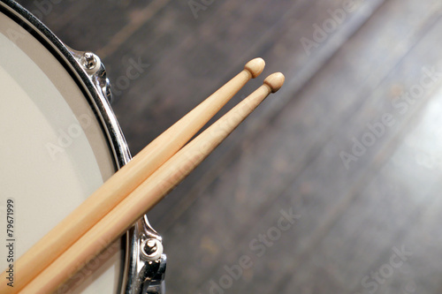 Drum sticks lay on an drum set