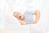 Mature man sleeping in a comfortable bed