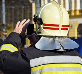 Firefighter takes photos with a smart phone