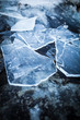 Pieces of ice on rock - 79675189