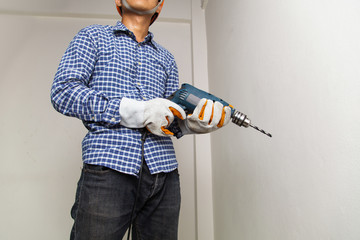 Man holding drilling tools