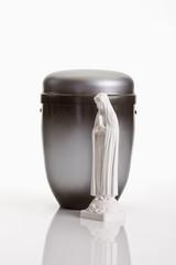 Bestattungsurne, Grau braune Urne aus Metall mit Heiligenfigur