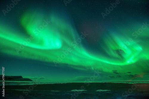Fototapeta A beautiful green aurora.