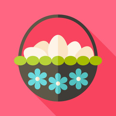 Easter basket with eggs and flowers