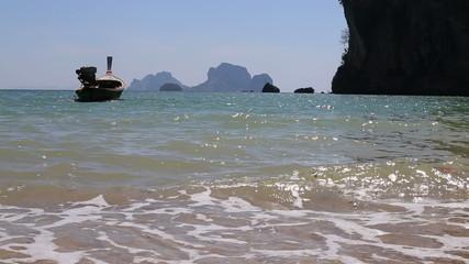 motor thai longtail boat drifts at sea coast
