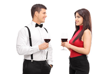 Couple drinking red wine and talking to each other