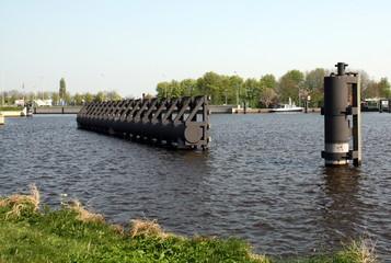 Mooring posts in Damsterdiep in the city of Groningen