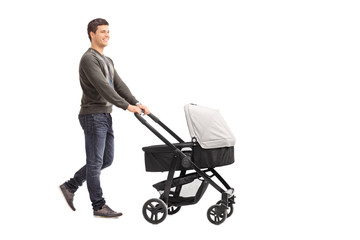 Young father pushing a baby stroller