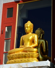 golden Buddha on the window