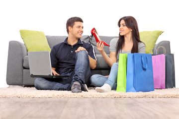 Woman showing her new shoes to her boyfriend