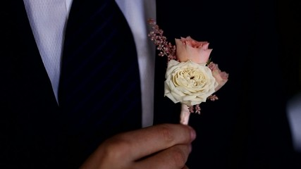The groom dresses