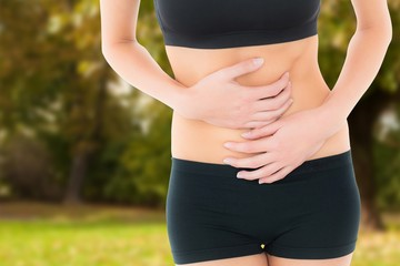 Fit young woman with stomach pain
