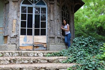 Girl near a strange house