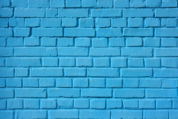 The brick wall painted in blue