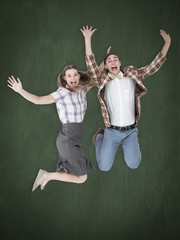 Composite image of geeky hipsters jumping and smiling