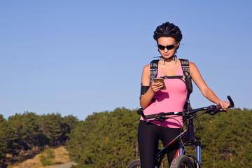 Girl in a helmet on a bike