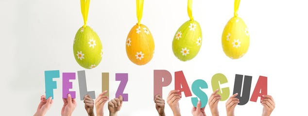 Composite image of hands holding up feliz pasqua