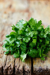 Fresh parsley on wooden surface