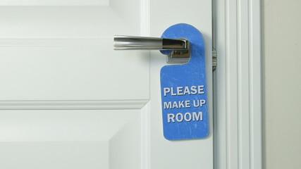 Blue hanger please make up room on the door handle of hotel room