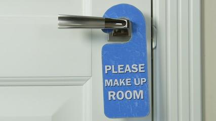 Hotel room door hanger please make up room closeup