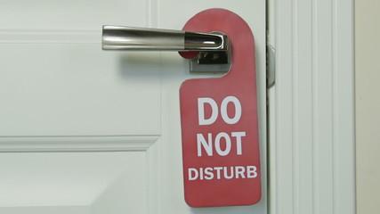 Do not disturb sign on hotel room door