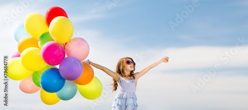 canvas print picture happy girl with colorful balloons
