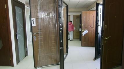 Customer in store showroom looking for armored  front door