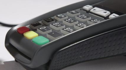 Person using credit card processing terminal closeup
